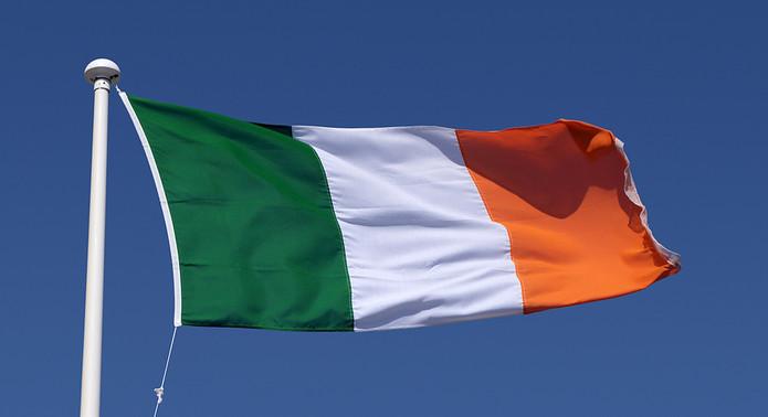 Irish Flag Against Blue Sky