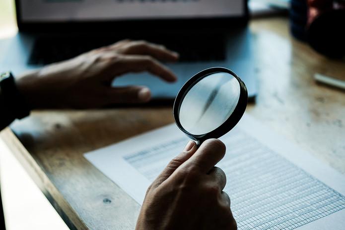 Magnifying Glass and Balance Sheet