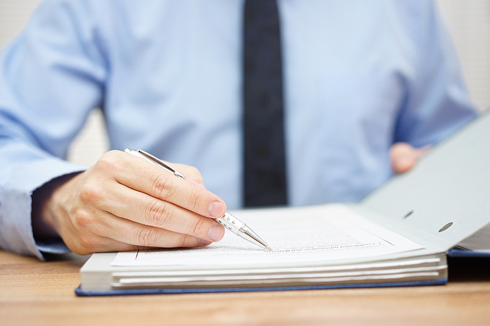 Man Examining Paperwork