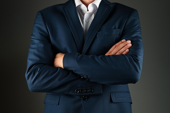Man In Suit With Crossed Arms