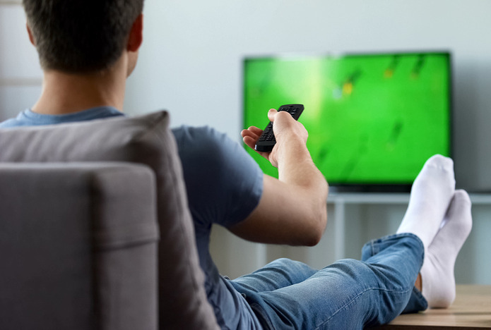 Man Watching Football on TV