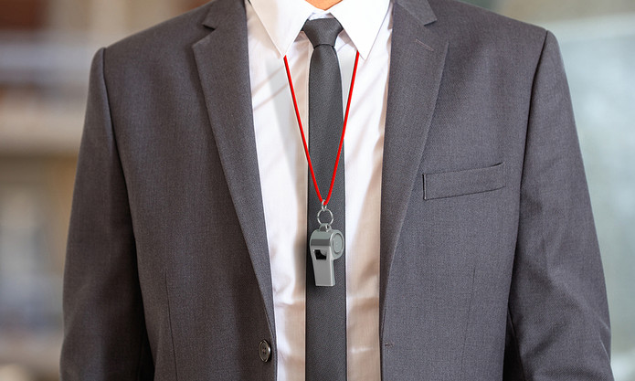 Man in Suit Wearing Whistle