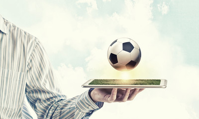 Man with Football on Tablet