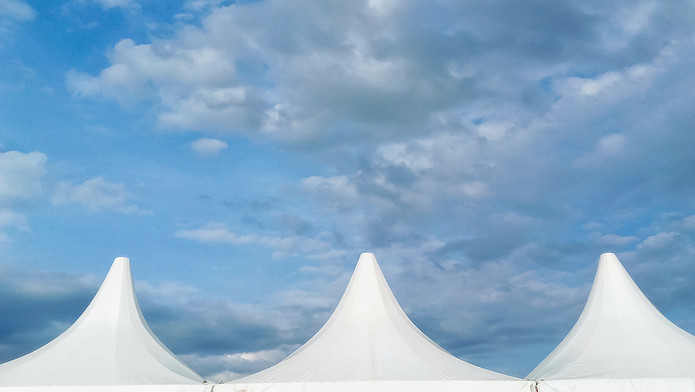 Marquee and Cloudy Sky