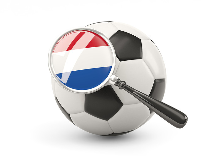 Netherlands Flag Under Magnifying Glass on Football
