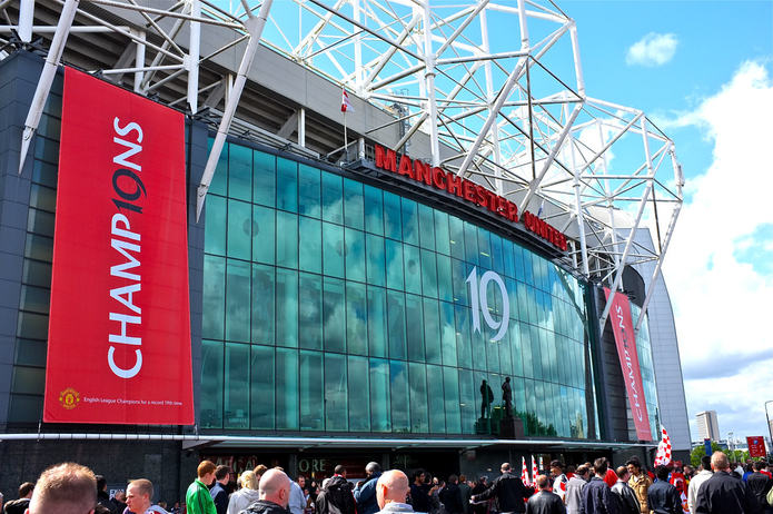 Manchester United's Old Trafford with Champions Banners