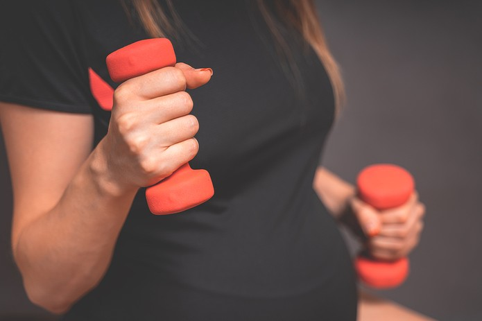 Pregnant Woman Holding Weights