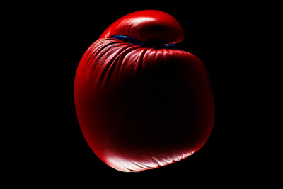 Red Boxing Glove with a Dark Background