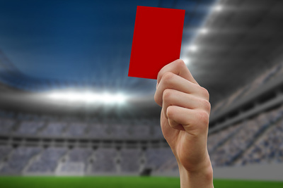 Red Card Held in Floodlit Stadium