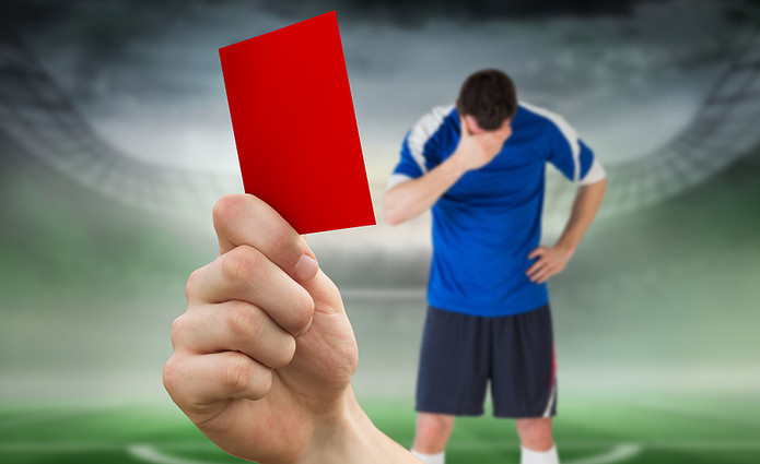 Red Card Shown to Player in Blue Kit