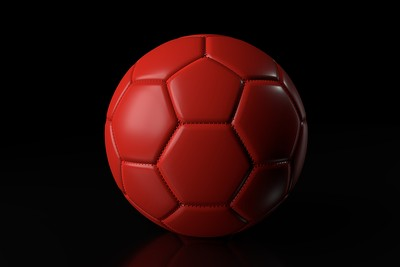Red Football Against a Black Background