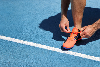 Runner Tying Shoe Lace