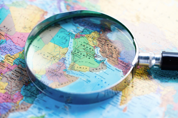 Saudi Arabia on Atlas with Magnifying Glass