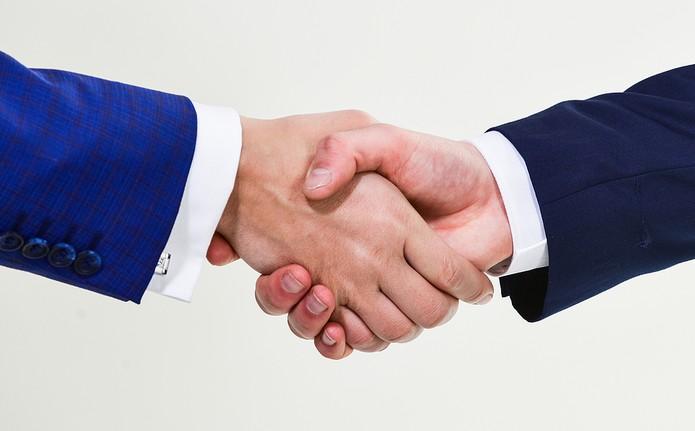 Shaking Hands at Meeting