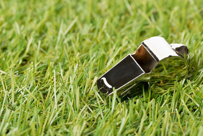 Silver Football Whistle on Grass