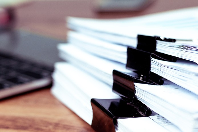 Stack of Documents on Desk