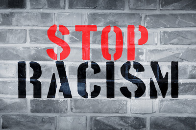 Stop Racism Stencilled on Brick Wall
