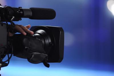 TV Camera Blue Background