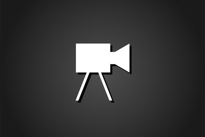 Television Camera Icon Against Black Background