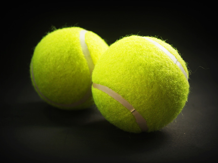 Tennis Balls Against Dark Background