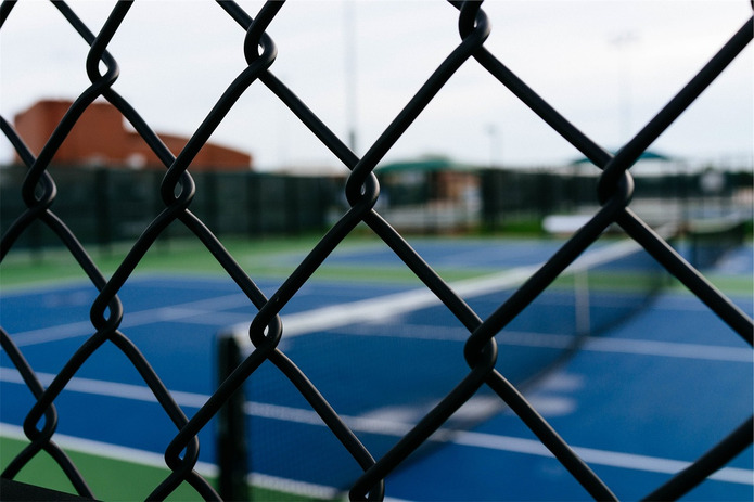 Tennis Courts Through Chainlink Fence