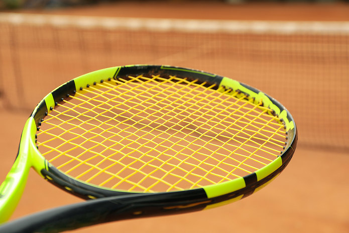 Tennis Racquet and Clay Court