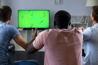 Three Friends Watching Football on Television