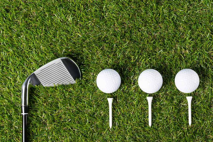 Three Golf Balls and Club