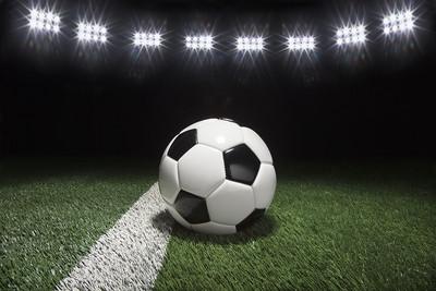 Traditional Football Under Floodlights
