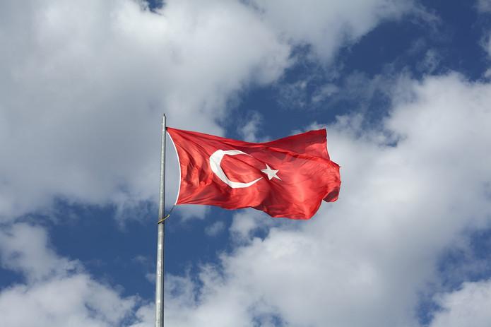 Turkish Flag Against a Cloudy Sky