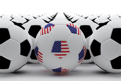 USA Flag Panelled Football Amongst Regular Footballs