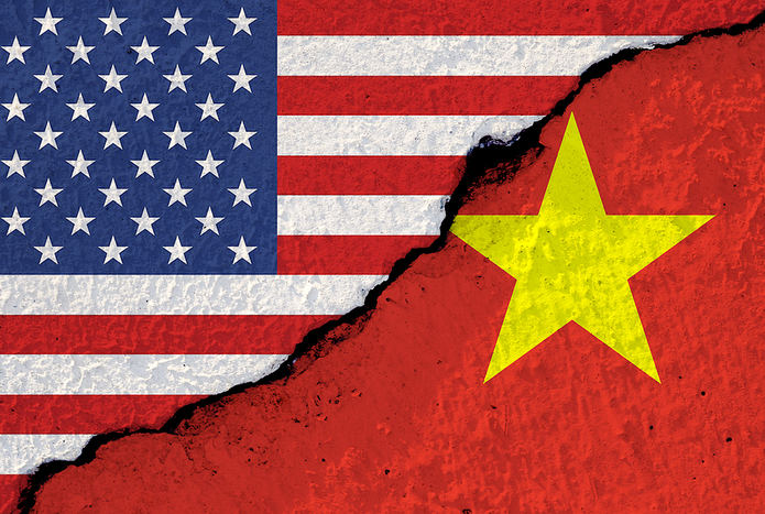 USA and Vietnam Flags on Cracked Wall