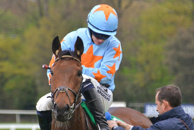 Racehorse Un De Sceaux with Jockey