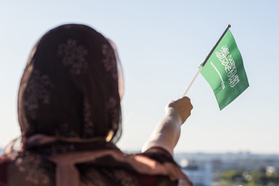 Woman Holding Saudi Flag