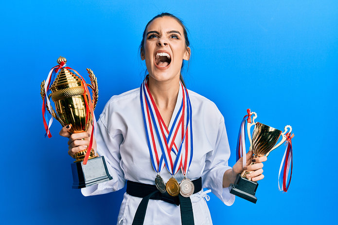 Woman Holding Trophies
