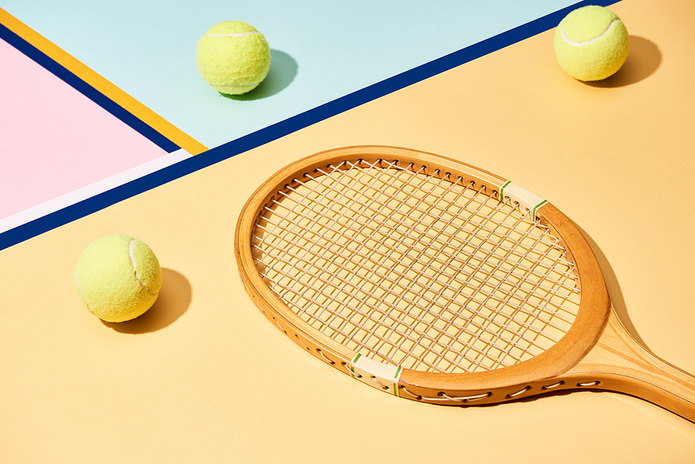 Wooden Tennis Racket Against Colourful Background
