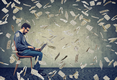 Young Man on Laptop with Falling Money